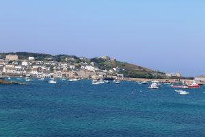 Hughtown and its harbor. Star Castle on the hill.