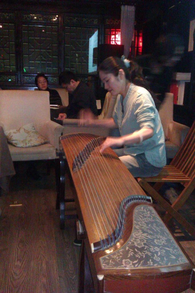 Poetry at Shu Yu's Café, Shu Yu playing the guzheng