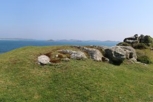 Innisidgen Burial Chamber looking across to Western Isles. Credit: R. Martin