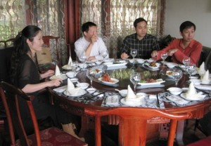 A typical banquet setting. Note the small rice-wine toasting glasses. Do not be deceived. (This one from a 2012 visit at West Lake, Hongzhou)