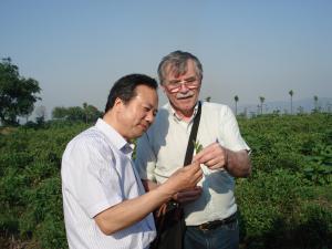 Poet Zhang Min-gui examining a tea leaf.