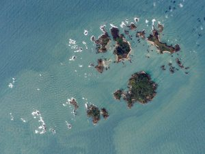 The Scillys from the International Space Station, (five larger, inhabited islands from l-r top: Brhyer, Tresco, St. Martins, bottom: St. Agnes, St. Mary's) Credit: NASA Earth Observatory