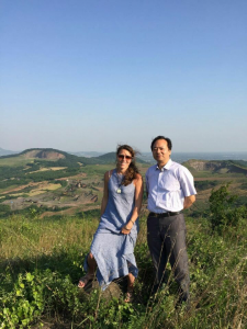 Daughterr and poet Zhang Min-gui with caldera in background. Credit Mi Zheng-ying