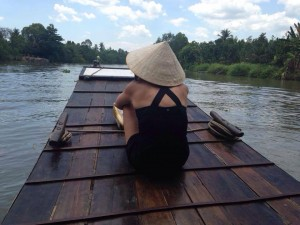 My daughter riding a sampan on the Mekong